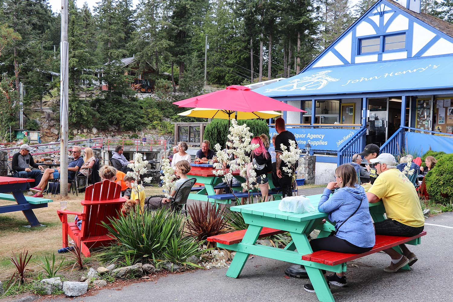 Customers enjoy an outdoor concert in front of the general store at John Henry's.