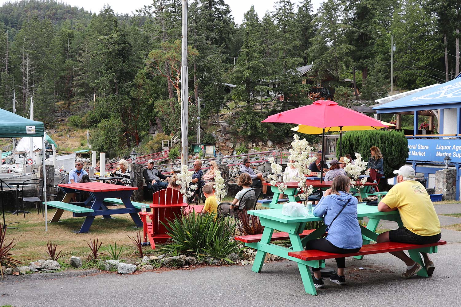 Customers enjoy an outdoor concert on the lawn of John Henry's General Store.