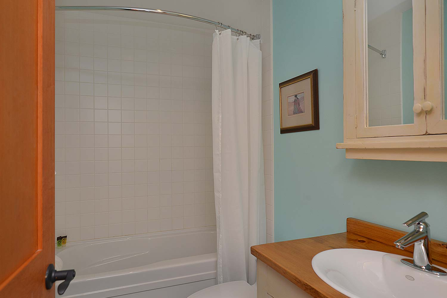 The large tub and shower in the Garden Suite bathroom of House 65 - a furnished home for rent on Pender Harbour.
