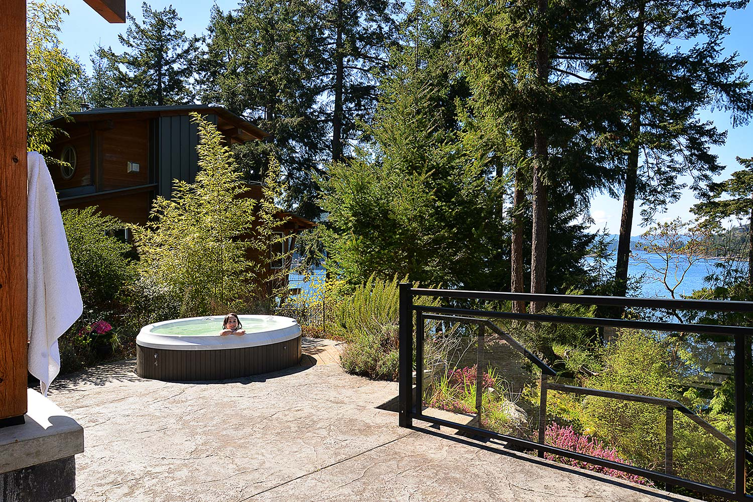 A child relaxes in the hot tub at the front of the house. Places to rent with a private hot tub available at John Henry's.