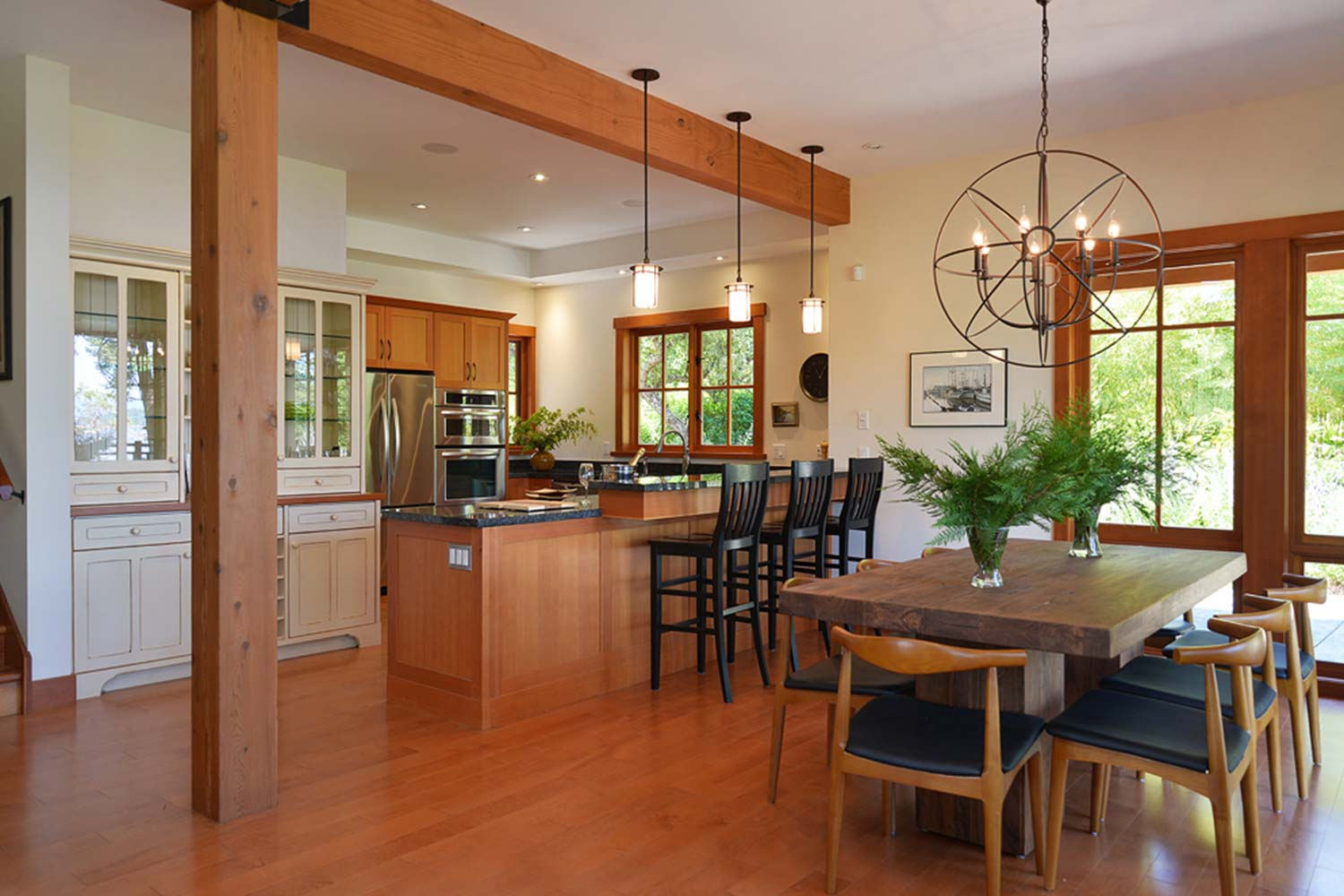 The kitchen and dining area of House 65, a luxury furnished rental house in Pender Harbour on the Sunshine Coast.