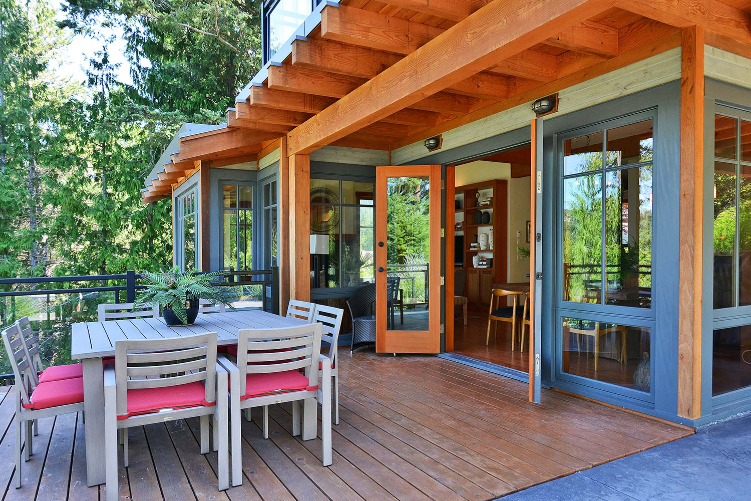 The living area opens up onto the large front deck where the outdoor dining area of this luxury vacation house is found.