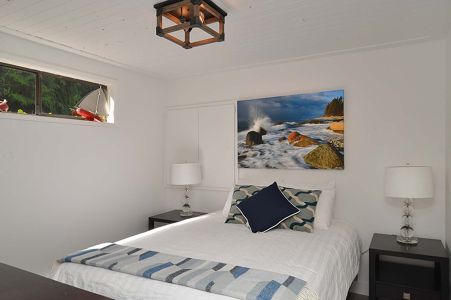 The bedroom in the cute cottage at John Henry's Marina & Resort. This Mussel Beach Cottage is one bedroom and fully furnished.