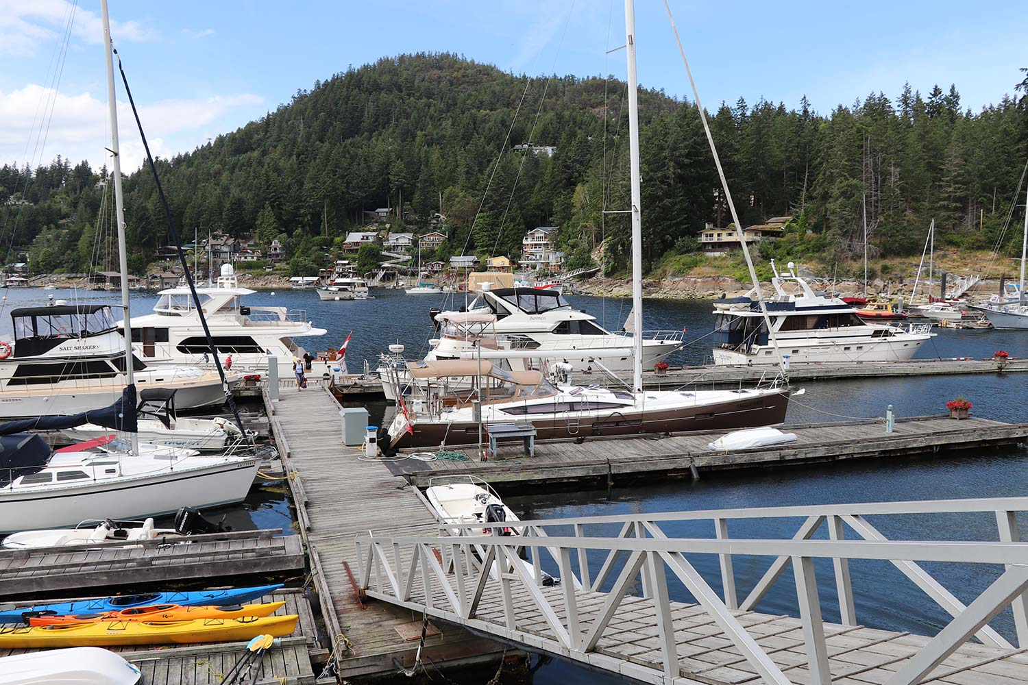 John Henry's Moorage on Garden Bay, Sunshine Coast filled with boats of different sizes. Moorage is available year-round.