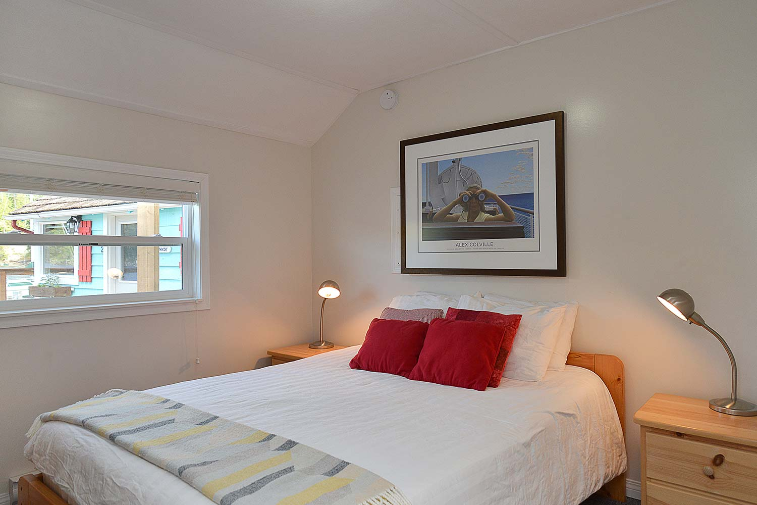 The bedroom of Prawn Palace. This cottage is one of the best places to stay in Sunshine Coast BC if you want ocean views.