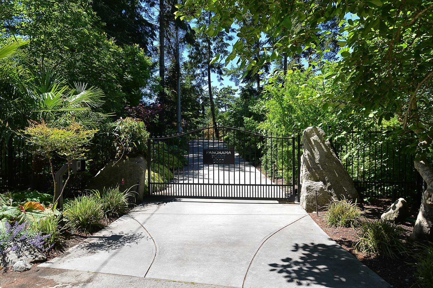 The gated front entrance to this beautifully landscaped luxury home rental on the Pender Harbour, Sunshine Coast.