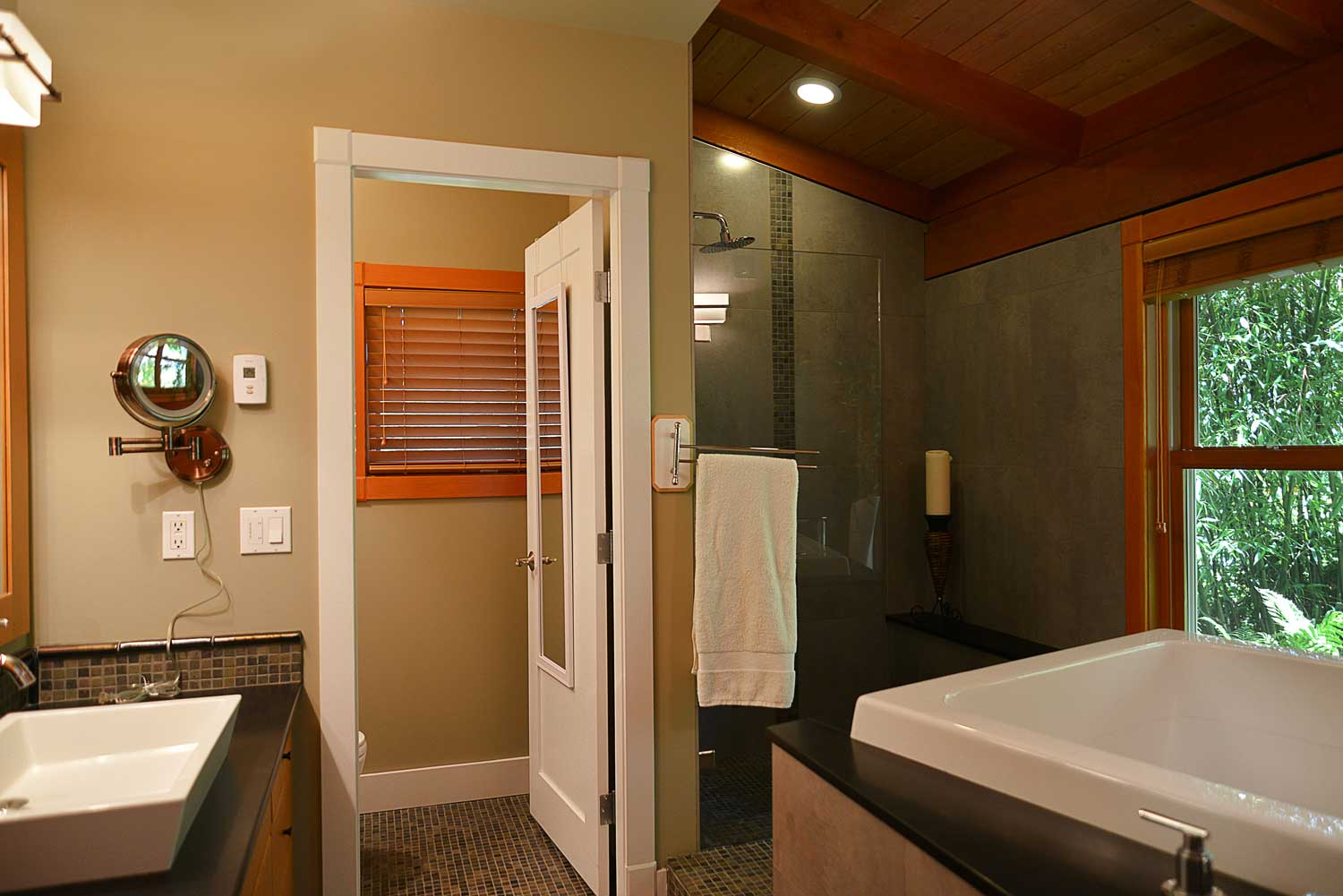 The master bathroom of this five-star holiday home comes equipped with a Japanese Furo tub and a deluxe shower.