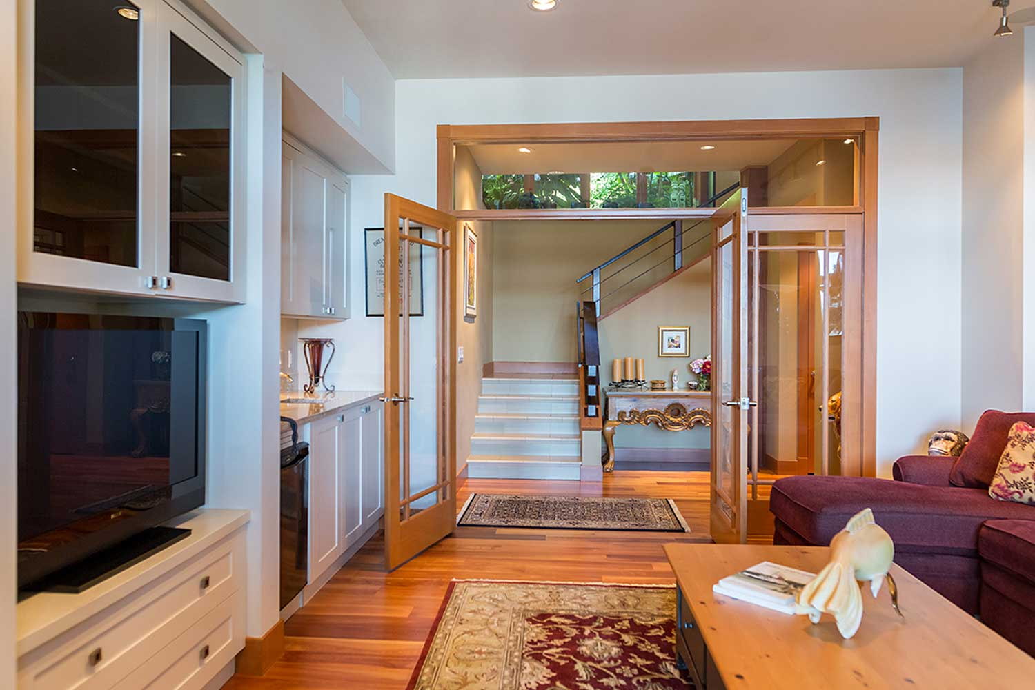 Doors open from the lounge to the upstairs area in this luxury Garden Bay, British Columbia accommodation.