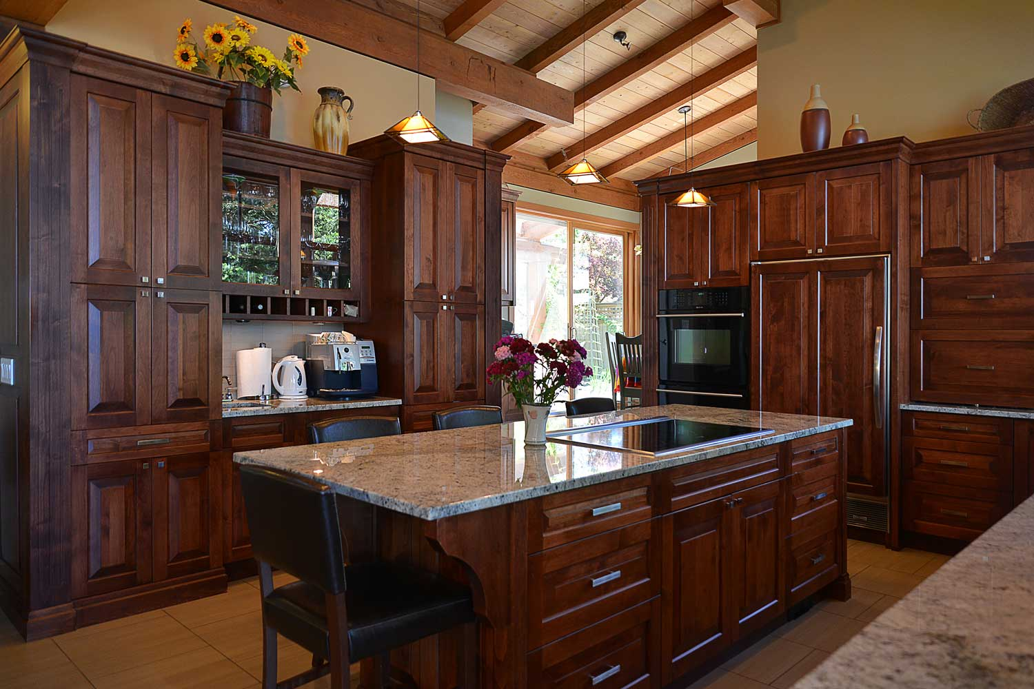 A rich, mahogany-coloured kitchen, with vaulted ceilings, in this luxury vacation house, is of top-chef quality.