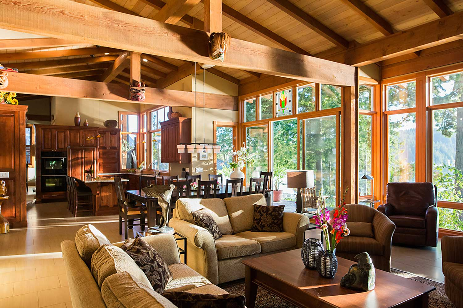 Sunlight streams through the windows to light up the dining room, kitchen, and living room of this luxury holiday house.