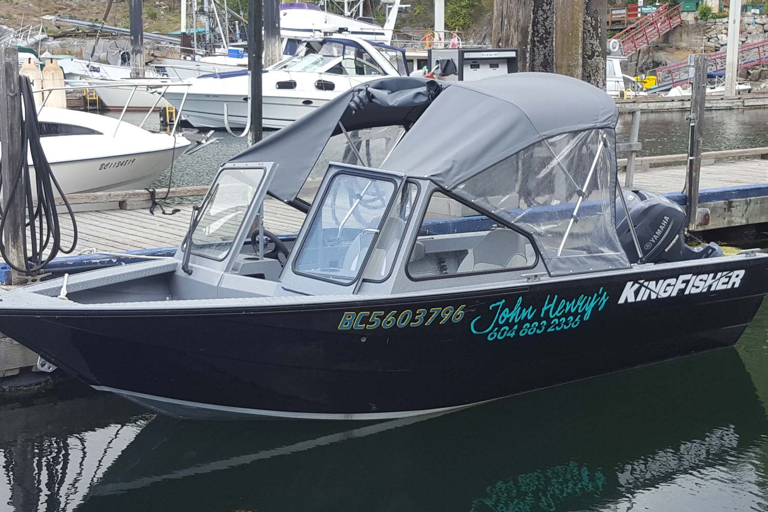 A 16-foot Kingfisher Falcon powerboat, equipped with a 75HP engine available at John Henry's Pender Harbour Boat Rentals.
