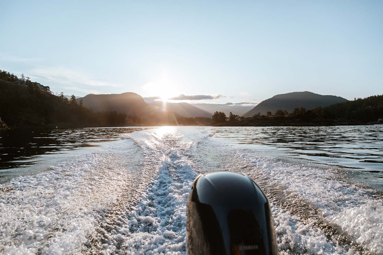 John Henry's powerboat engine gets up to speed and creates a wake in the sunny Pender Harbour.