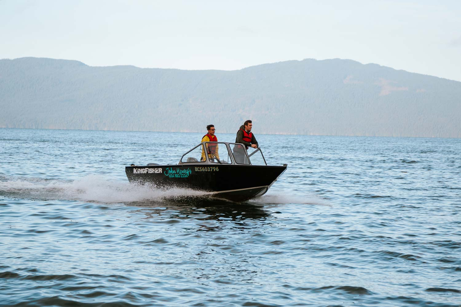 Two men in a boat on the Pender Harbour, boating around the 60 kilometers of shoreline and bays is a popular pastime.