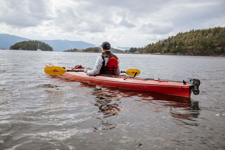 Kayaker takes his Sunshine Coast BC kayak rental onto the beautiful, calm waters of Pender Harbour.