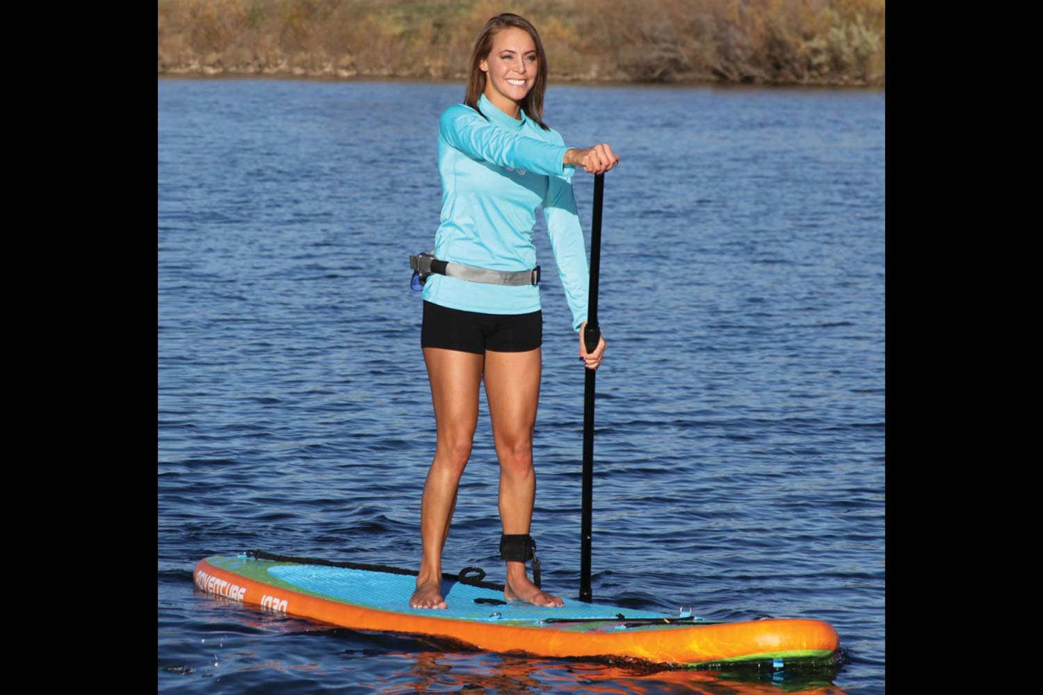 A happy customer using her SUP Rental from Pender Harbour BC. SUPs and Kayaks available at John Henry's.