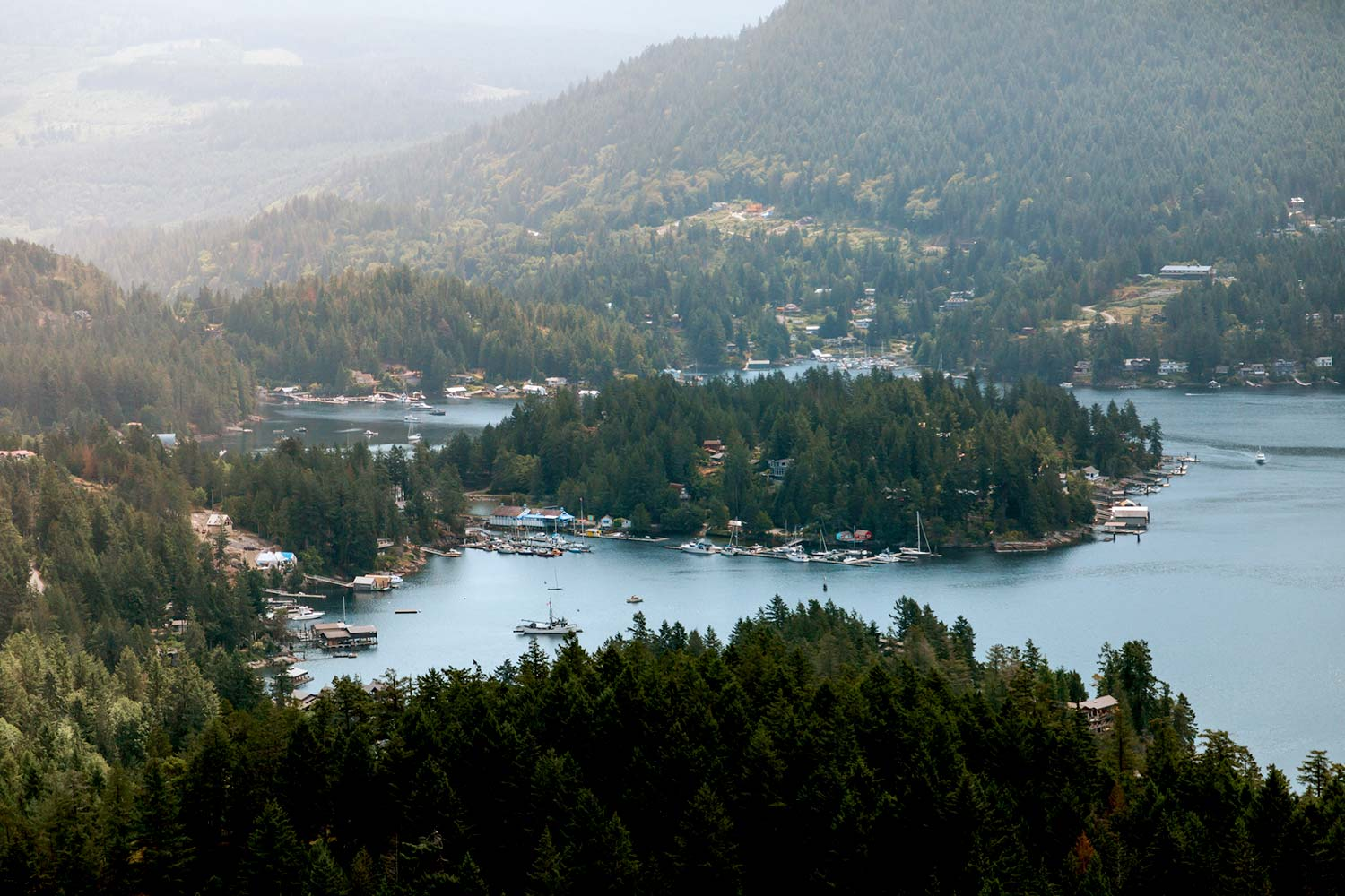 Aerial view of boats moored at John Henry's Marina in the Pender Harbour, and the surrounding residents on the Sunshine Coast in Canada.